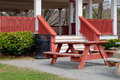 Picnic tables and pavilion park place with table benches outside as well as under cover of Royalty Free Stock Image