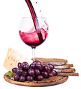 Picnic with wine and food lunch on a wooden board including a bread cheese grapes Stock Images