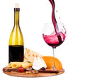 Picnic with wine and food lunch on a wooden board including a bread cheese grapes Stock Image