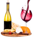 Picnic with wine and food lunch on a wooden board including a bread cheese grapes Stock Photo
