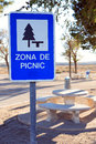 Picnic zone roar sign near table on background with road Stock Photos