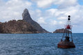 Pico hill fernando de noronha brazil rock and the blue atlantic ocean archipelag pernambuco a steel buoy is at the first plane Stock Image