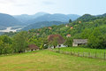 Pictorial landscape of mountain village with a palisade serbia meadow white house and drina river in the background western Stock Image