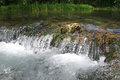 Pictorial river cascade and foamed, rushing water, Serbia Royalty Free Stock Photo