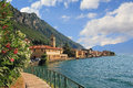Pictorial village gargnano lago die garda di lakeside promenade with oleander and church Stock Photography