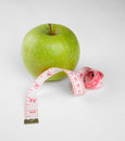 Picture of apple and tape measure green Royalty Free Stock Photography
