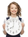 Picture beautiful girl big clock Stock Photos