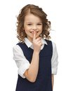 Picture beautiful pre teen girl showing hush gesture Royalty Free Stock Photo
