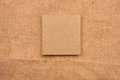 Picture of beige leather photo album cover on jute background. K Royalty Free Stock Photo