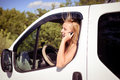 Picture of blond girl speaking phone and looking portrait from car window young woman excited smiling while talking with someone Royalty Free Stock Image
