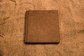 Picture of brown leather photo album cover on jute background. K Royalty Free Stock Photo
