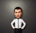 Picture of businessman with big head funny over dark background Royalty Free Stock Photography