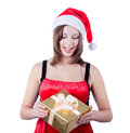 Picture of cheerful santa helper girl with gift box this image has attached release Stock Images