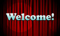 Picture with a curtain that falls on the light from the projector with an inscription welcome Royalty Free Stock Photo