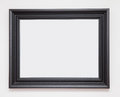 Picture frame blank black on white wall Stock Photo