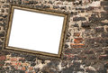 Picture frame crookedly hung over ruined brick wall Royalty Free Stock Photography