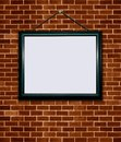 Picture frame on wall brick Stock Photo