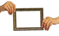 Picture frame in woman hand Royalty Free Stock Image