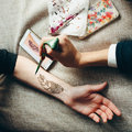 Picture hand being decorated with henna tattoo Royalty Free Stock Photo