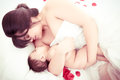 Picture of happy mother with baby over white this image has attached release Royalty Free Stock Photos