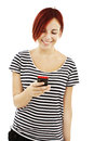 Picture of happy teenage girl with cell phone Stock Images