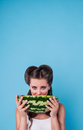 Picture of happy young woman holding a big slice watermelon in the studio Royalty Free Stock Photo