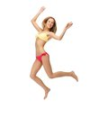 Picture of jumping woman in bikini bright Royalty Free Stock Photography