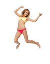 Picture of jumping woman in bikini bright Stock Photo