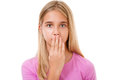 Picture of lovely young girl with hand over mouth.Isolated Royalty Free Stock Photo