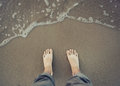 Picture of male bare foot near the sea water photo Royalty Free Stock Photo