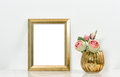 Picture mock up with golden frame amd flowers. Vintage interior