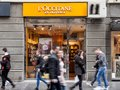 L`Occitane en Provence logo on their shop of Belgrade, people passing by. This brand is the most known Southern France Cosmetics Royalty Free Stock Photo