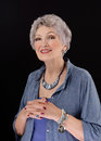 Picture of older woman posing with paua shell stick bar beads