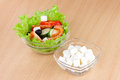 Picture of plates with greek salad and feta on table Stock Image