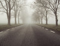 Picture presenting the foggy day road Stock Images