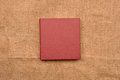 Picture of red leather photo album cover on jute background. Kee Royalty Free Stock Photo