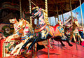 Picture of a retro carousel horse with the background of the carousel Royalty Free Stock Photography