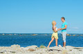 Picture of romantic young couple by the sea. Royalty Free Stock Photo