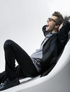 Picture of seated young fashion man Royalty Free Stock Photography