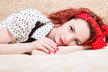Picture of sensual red haired young woman beautiful pinup girl having fun relaxing lying in bed smiling looking at camera closeup Stock Image