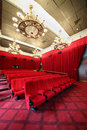 Picture show with chandeliers and rows of seats beautiful red curtains Stock Image