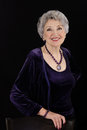 Picture of spectacular older woman posing with amethyst jewelry