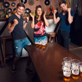 Picture of sweet adult woman and twins playing beerpong at bar Royalty Free Stock Photo