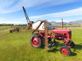 Picture of a tractor and abandoned machines Royalty Free Stock Photo