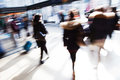 Picture of walking people at the station shown in motion blur Royalty Free Stock Image