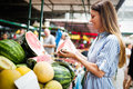 Picture of woman at marketplace buying fruits Royalty Free Stock Photo