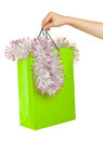 Picture of woman s hand with green shopping bag and spangle Stock Images