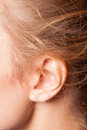 Picture of the womens ear this image has attached release Stock Image