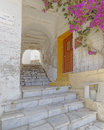 Picturesque alley and bougainvillea flower in a mediterranean island Royalty Free Stock Images