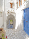 Picturesque arcade alley in a mediterranean island Royalty Free Stock Photos
